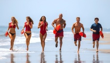 (L-R) Kelly Rohrbach as CJ Parker, Alexandra Daddario as Summer, Ilfenesh Hadera as Stephanie Holden, Dwayne Johnson as Mitch Buchannon, Zac Efron as Matt Brody and Jon Bass as Ronnie in the film, BAYWATCH by Paramount Pictures, Montecito Picture Company, FlynnPicture Co., and Fremantle Productions